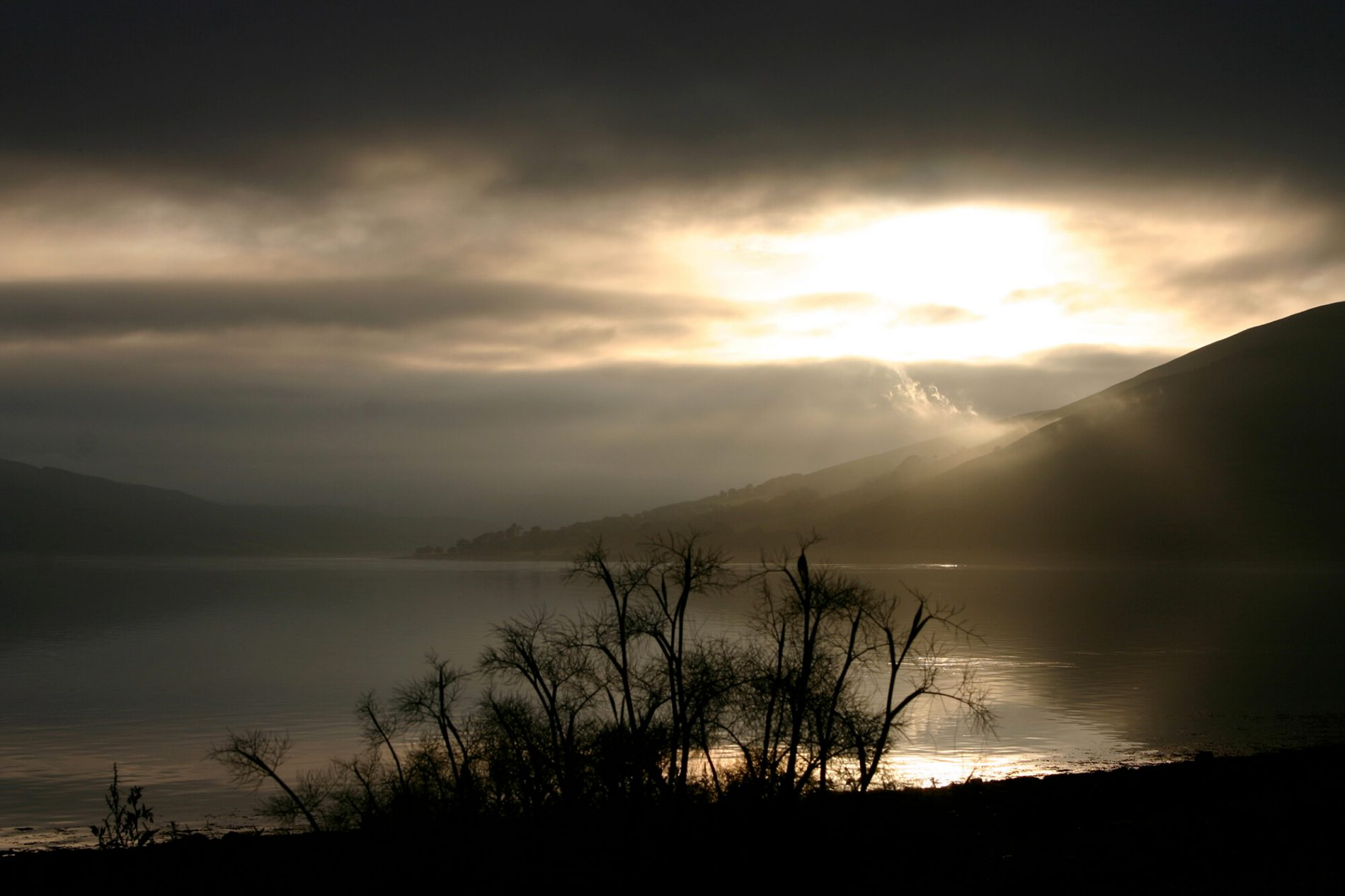 View of the Loch with sunbeams between stormy clouds from Jane Kelly's Studio